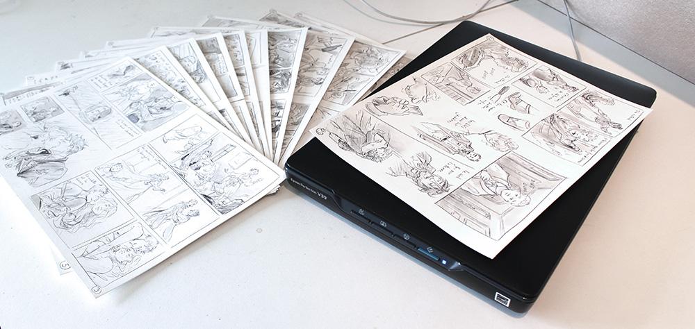 pages de BD noir et blanc et scanner